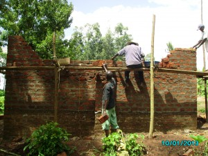 Once the walls reached a height requiring it, scaffolding was put around the building.. and work on the walls continued higher and higher..