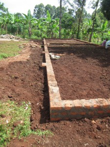 """Once the foundation perimeter was completed (please see Part One for photos to that point..) the floor area was dug out and the soil used to back fill around the """"wall trenches""""."""