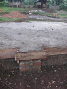 """The floor is all ready now for a layer of special """"moisture barrier"""" plastic, followed by wire, covered by aggregates ( gravel ) mixed with cement."""