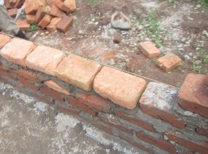 """Work began on the brick walls. They will be """"plastered"""" and sealed with a finishing layer of concrete later."""