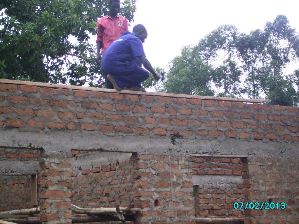 Timber was fixed to the top row of bricks all along the walls..