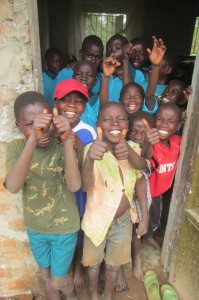 Boys at ACIO - Aids Concern Integrated Organization - in Sironko, Uganda celebrate on the threshold of their new dorm, completed Spring 2013, made possible by the generosity, kindness and Love of contributors !