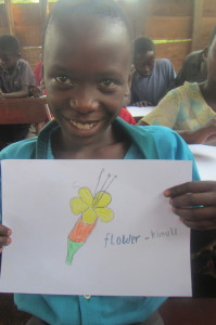 "Representing the letter ""F"" for our dictionary, Lydia shows us her beautiful flower/kimuli (English/Lumasaba)"