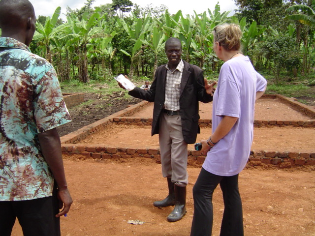 Bonny Mark(L) our Ugandan Rep and I are visited, welcomed and thanked at the site by the local Chairman. He shares with us that the community is very happy, very grateful and proud of this project and he send deep thanks to all who are making it possible.