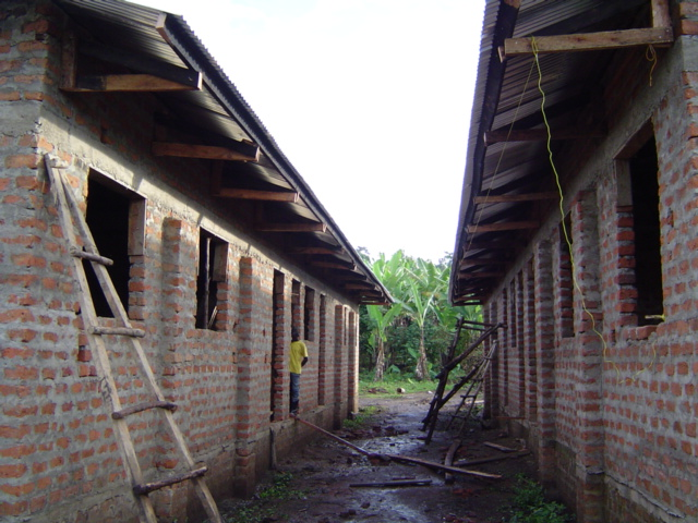 The center entrance of the buildings, that's the boy's home on the left, and the girl's on the right.