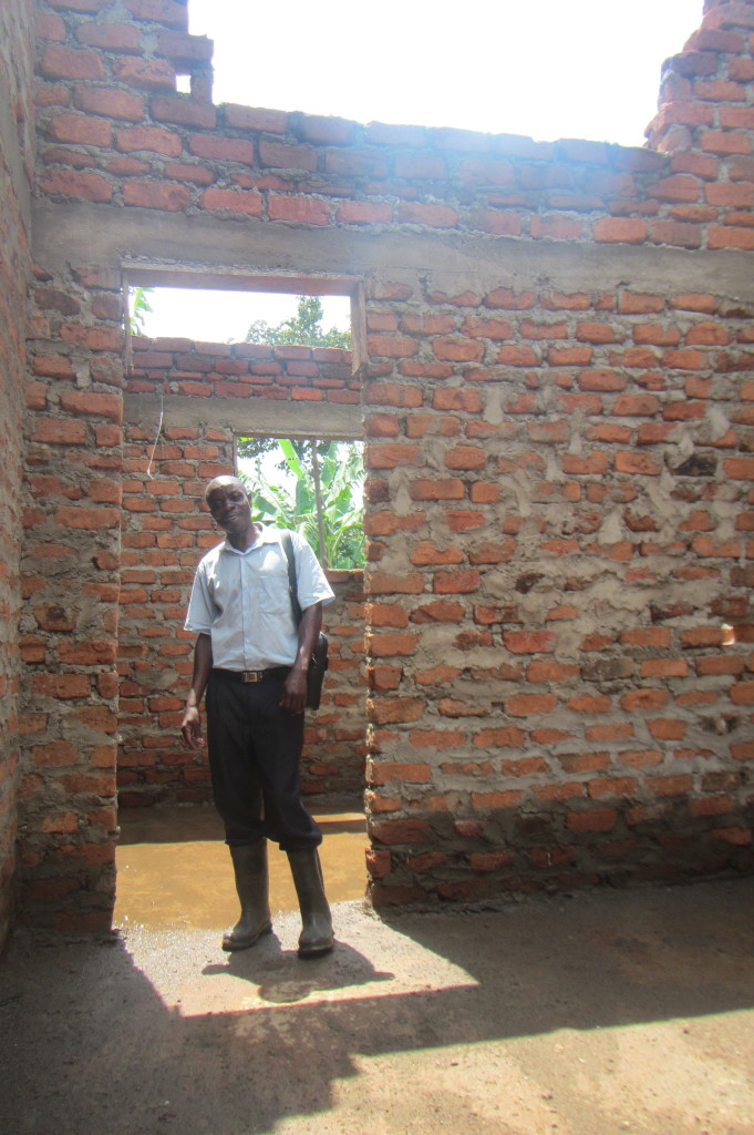 Foreman Daniel standing in the doorway of the two centre rooms in one of the dorms.. each dorm has the two rooms and will likely end up being used as an office in each, with a library in one and a nursing station in the other