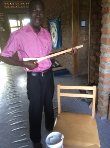 LITA's Ugandan Agent, Bonny Mark, dropped by for a visit and some strumming!