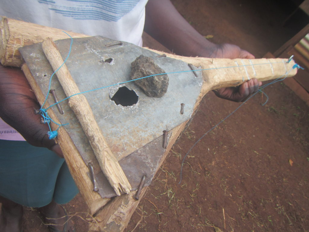 Inspired by the music project and lacking an instrument over the holidays, one of the students made his own, from materials found in the village! Sounds pretty awesome too!